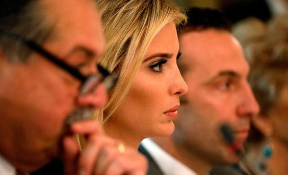 Ivanka Trump attends a meeting held by US President Donald Trump with manufacturing CEOs at the White House in Washington yesterday