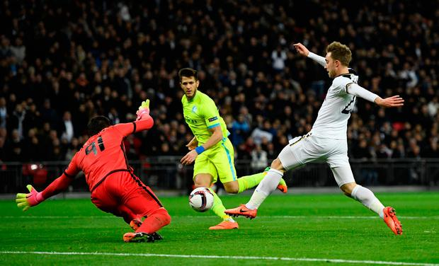 Gent's Lovre Kalinic in action with Tottenham's Christian Eriksen. Photo: Reuters