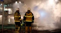 Firefighters at the scene of a riot in which several cars were set on fire in the Stockholm suburb of Rinkeby, Sweden, an area with a large migrant population. Photo: Getty