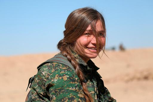 A female fighter in the Syrian Democratic Forces (SDF), in Deir al-Zor province, Syria, ahead of an offensive against Isil. Photo: Rodi Said/Reuters