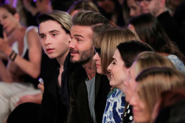 Brooklyn Beckham, David Beckham, and Anna Wintour attend the Victoria Beckham Spring/Summer 2017 fashion show during New York Fashion Week 2016 on September 11, 2016 in New York City. (Photo by Neilson Barnard/Getty Images)