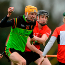 Jack Fagan of IT Carlow in action against University College Cork's, from left, Rickard Cahalane, Conor Gleeson and Ian Kenny during the Independent.ie HE GAA Fitzgibbon Cup semi-final
