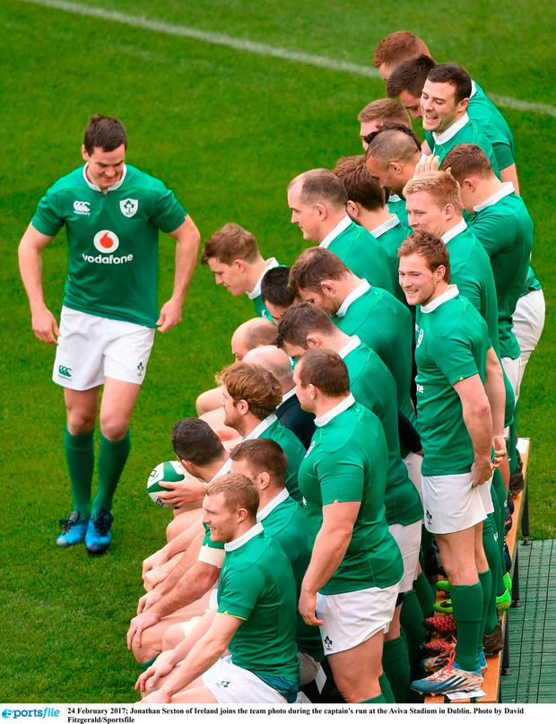 24 February 2017; Jonathan Sexton of Ireland joins the team photo during the captain's run at the Aviva Stadium in Dublin. Photo by David Fitzgerald/Sportsfile