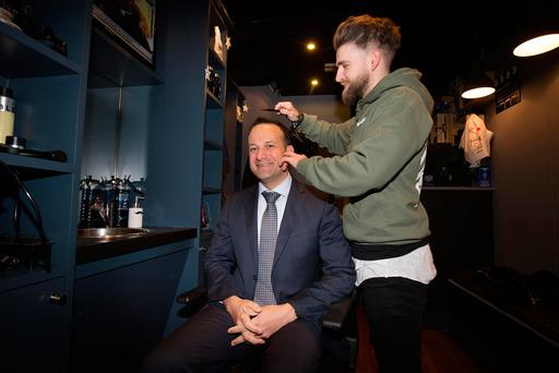 Minister for Social Protection Leo Varadkar gets his hair styled by salon owner Robert Giffney at the launch of the Back to Work Enterprise Scheme at Him Barber Shop in Glasnevin. Photo: Tony Gavin