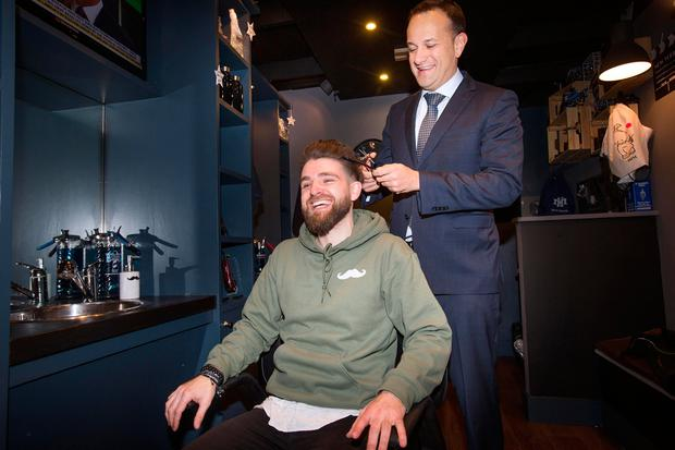 Minister for Social Protection Leo Varadkar cuts the hair of salon owner Robert Giffney at the launch of the Back to Work Enterprise Scheme at Him Barber Shop in Glasnevin. Photo: Tony Gavin
