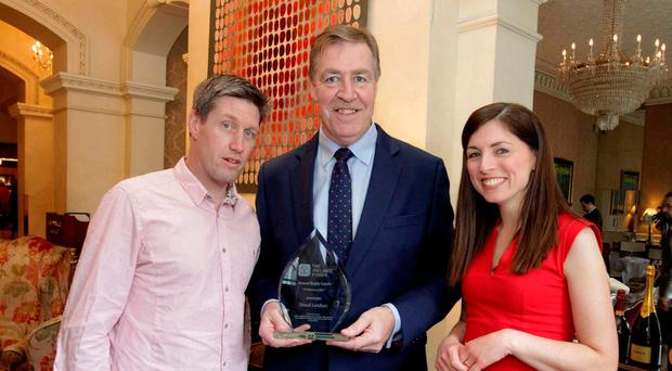Donal Lenihan, centre, is pictured with RTE presenter Joanne Cantwell and Ronan O'Gara at the 9th annual Ireland Funds Rugby Lunch in Dublin's Shelbourne Hotel. Former Ireland international rugby player, Donal Lenihan was honoured at the fundraiser event, with over 400 guests in attendance. PHOTO: Mark Stedman