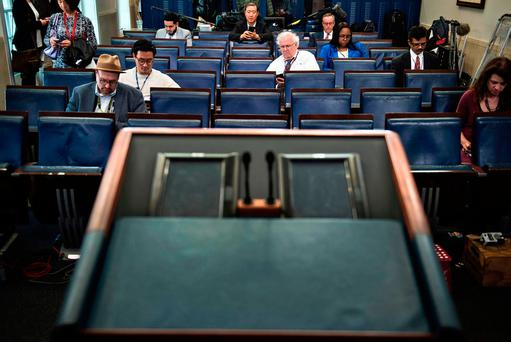 An empty podium is seen as an off camera briefing is held with a small group of reporters and White House Press Secretary Sean Spicer instead of the normal on camera briefing in the White House. / AFP PHOTO / Brendan SmialowskiBRENDAN SMIALOWSKI/AFP/Getty Images