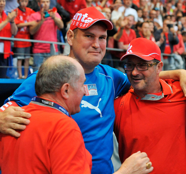 Aurillac's Irish coach Jeremy Davidson (centre) celebrates a victory over Mont-de-Marsan last season with Thierry Peuchlestrade (right) Photo: THIERRY ZOCCOLAN/AFP/Getty Images