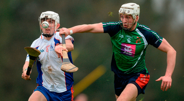 Aaron Gillane of Mary Immaculate College in action against Barry O'Connell of Limerick IT Photo: Piaras Ó Mídheach/Sportsfile