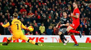 Southampton's Shane Long scores in the League Cup semi-final. Photo: Martin Rickett/PA Wire.