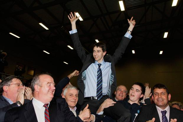 Simon Harris celebrates as he wins his Dáil set in Greystones in 2011. Photo: Michael Kelly