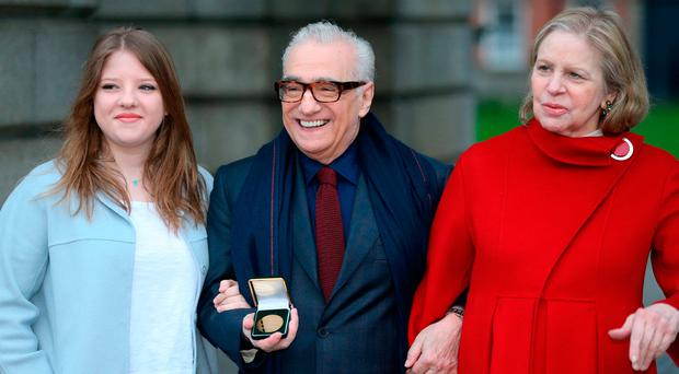 Film director Martin Scorsese (centre), with his wife Helen Morris (right) and daughter Francesca, holds a gold medal awarded to him by students of Trinity College's debating society: Brian Lawless/PA Wire