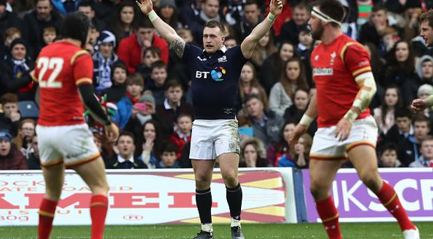 EDINBURGH, SCOTLAND - FEBRUARY 25: Stuart Hogg of Scotland celebrates his team's 29-13 victory as the final whistle blows during the RBS Six Nations match between Scotland and Wales at Murrayfield Stadium on February 25, 2017 in Edinburgh, Scotland. (Photo by David Rogers/Getty Images)