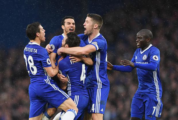 LONDON, ENGLAND - FEBRUARY 25: Pedro of Chelsea (C) celebrates scoring his sides second goal with his Chelsea team mates during the Premier League match between Chelsea and Swansea City at Stamford Bridge on February 25, 2017 in London, England. (Photo by Darren Walsh/Chelsea FC via Getty Images)