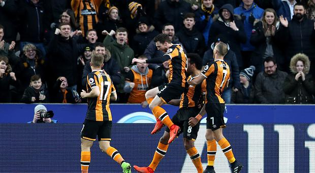 HULL, ENGLAND - FEBRUARY 25: Tom Huddlestone of Hull City (obscure) celebrates scoring his sides first goal with his Hull City team mates during the Premier League match between Hull City and Burnley at KCOM Stadium on February 25, 2017 in Hull, England. (Photo by Mark Robinson/Getty Images)