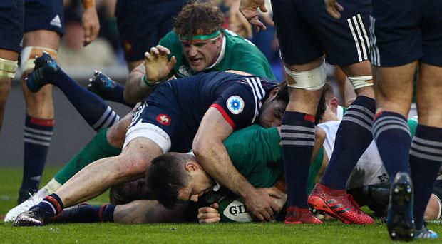 DUBLIN, IRELAND - FEBRUARY 25: Conor Murray of Ireland burrows over to score the opening try during the RBS Six Nations match between Ireland and France at the Aviva Stadium on February 25, 2017 in Dublin, Ireland. (Photo by Ian Walton/Getty Images)