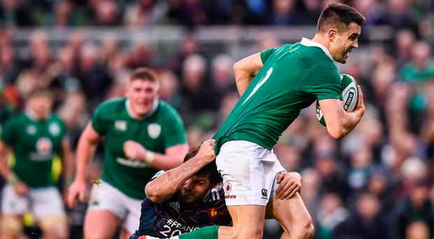 Conor Murray is tackled by Kevin Gourdon. Photo: Stephen McCarthy