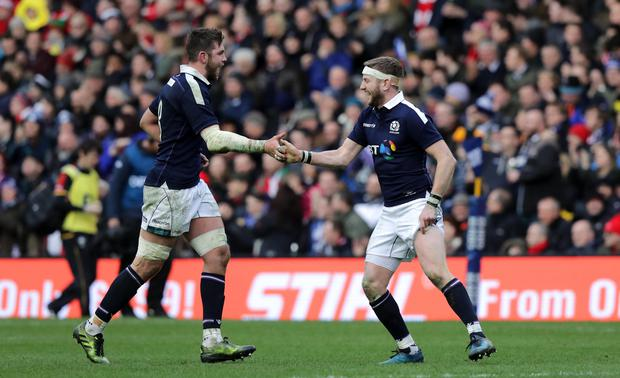 Scotland's Ryan Wilson and Finn Russell celebrate a penalty during the game. Photo: INPHO