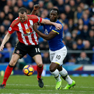 Sunderland defender John O'Shea attempts to keep Everton striker Romelu Lukaku at bay. Photo: Reuters