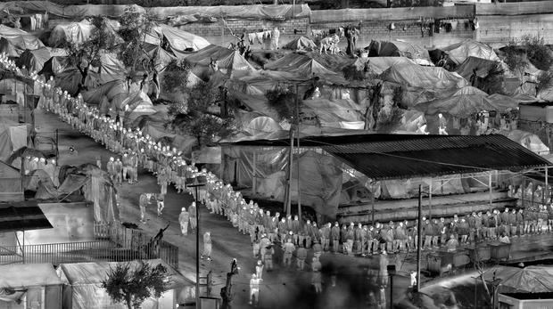 MOVING PICTURES: Images from 'Incoming', an installation created by Irish photographer Richard Mosse, who used a thermal-imaging camera designed for the military to document Europe's refugee crisis. Photo: Tristan Fewings/Getty Images