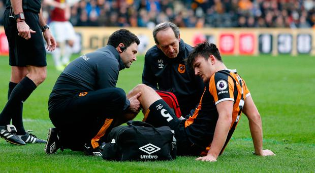Hull City's Harry Maguire receives medical treatment after sustaining a injury. Photo: Reuters