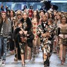 Models walk the runway at the end of the show for fashion house Dolce & Gabbana during the Women's Fall/Winter 2017/2018 fashion week in Milan (Getty Images)
