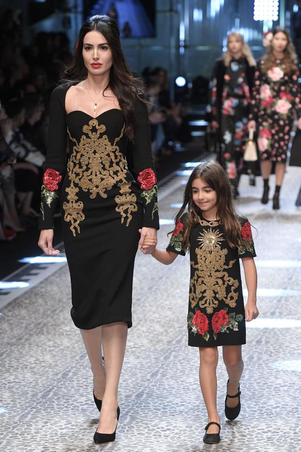 5c56fc0280a Models present creations for fashion house Dolce   Gabbana during the  Women s Fall Winter 2017
