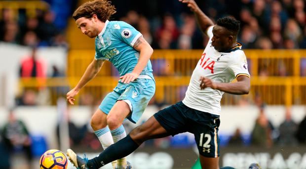 Stoke City's Joe Allen (left) and Tottenham Hotspur's Victor Wanyama (right) battle for the ball. Photo credit: Steven Paston/PA Wire
