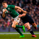 Garry Ringrose attempts to break through the tackle of Louis Picamoles during Saturday's Six Nations clash at the Aviva Stadium. Photo: Brendan Moran/Sportsfile