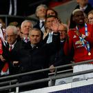 Manchester United manager Jose Mourinho lifts the trophy at the end of the match