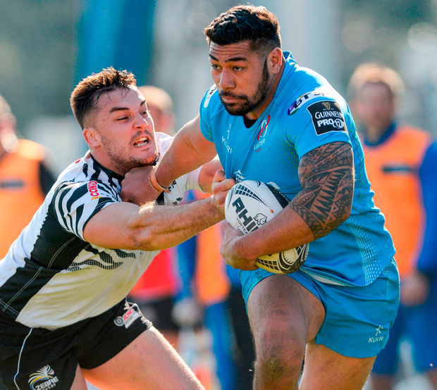 Ulsters Charles Piutau brushes past Zebre's Llord Greeff. Photo: Massimiliano Pratelli/Sportsfile