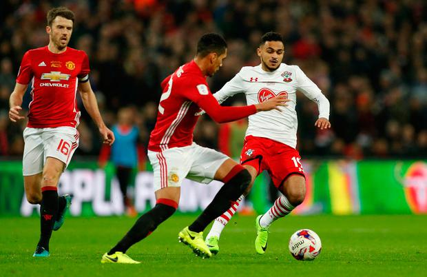 Southampton's Sofiane Boufal in action with Manchester United's Chris Smalling. Photo: Reuters / John Sibley