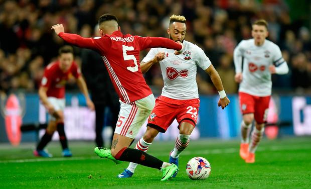 Southampton's Nathan Redmond in action with Manchester United's Marcos Rojo. Photo: Reuters / Hannah McKay