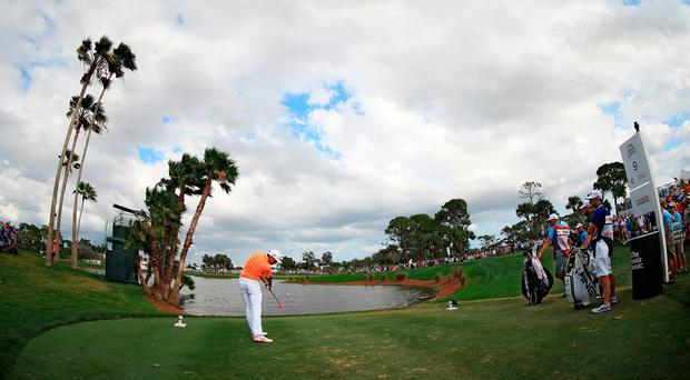 Rickie Fowler playes his tee shot at the ninth during the final round of the Honda Classic. Photo by Mike Ehrmann/Getty Images