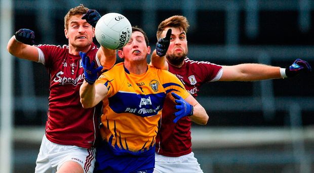 There's no quarter asked or given as Clare's Cathal O'Connor (centre) battles for possession with Galway pair Gary O'Donnell (left) and Paul Conroy during the Allianz NFL Division Two clash in Pearse Stadium. Photo by Ramsey Cardy/Sportsfile