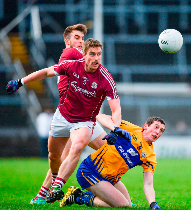 Gary O'Donnell of Galway in action against Cathal O'Connor of Clare. Photo by Ramsey Cardy/Sportsfile