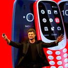 Arto Nummela, Chief Executive Officer at HMD Global, shows the new relaunched Nokia 3310 phone. Photo: AP Photo/Emilio Morenatti
