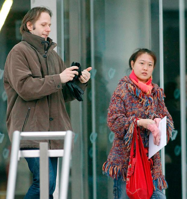 Daniel Belling and his wife, Xing Lei Li, right, were on the cruise ship in the Mediterranean with their two sons when Ms Xing went missing. Mr Belling claims she is in Dublin or China. Photo: Kyran O'Brien
