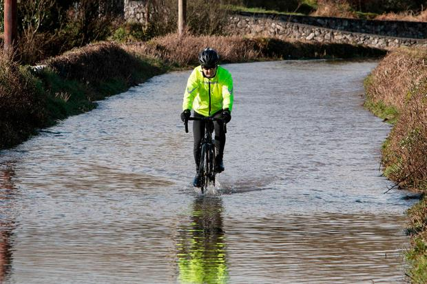 A cyclist tests the water at Erinagh near Ennis in Co Clare. Photo: Press 22