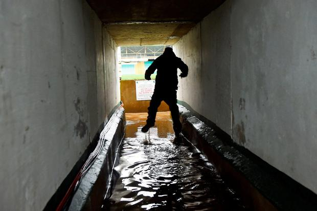 Flooding in the tunnel at MacCumhaill Park in Ballybofey, Co Donegal, ahead of the league match between Donegal and Dublin. Photo: Philip Fitzpatrick/Sportsfile;
