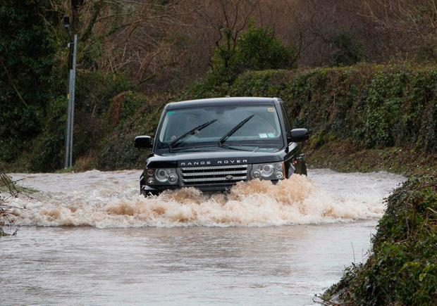 A driver braves the floods, also in Co Clare. Photo: Press 22