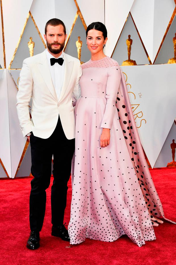 Actors Jamie Dornan (L) and Amelia Warner attend the 89th Annual Academy Awards at Hollywood & Highland Center on February 26, 2017 in Hollywood, California. (Photo by Frazer Harrison/Getty Images)