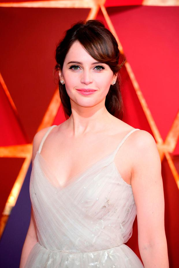 Felicity Jones arriving at the 89th Academy Awards held at the Dolby Theatre in Hollywood, Los Angeles. Photo: Ian West/PA Wire