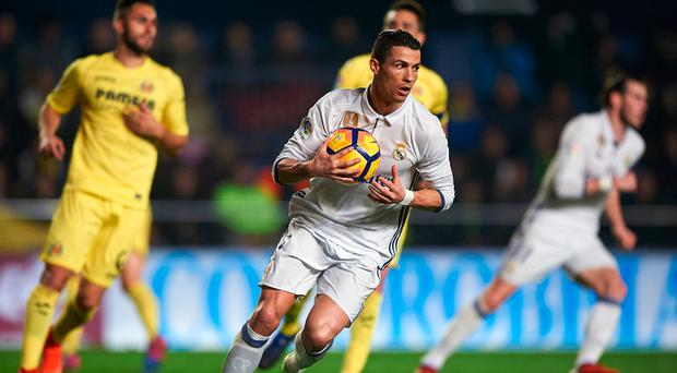 Cristiano Ronaldo (C) of Real Madrid reacts after scoring the second goal during the La Liga match between Villarreal CF and Real Madrid at Estadio de la Ceramica in Villarreal, Spain. (Photo by Fotopress/Getty Images)