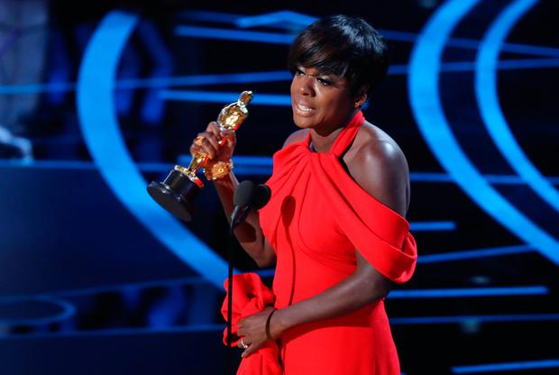 Viola Davis accepts the award for Best Supporting Actress for her role in