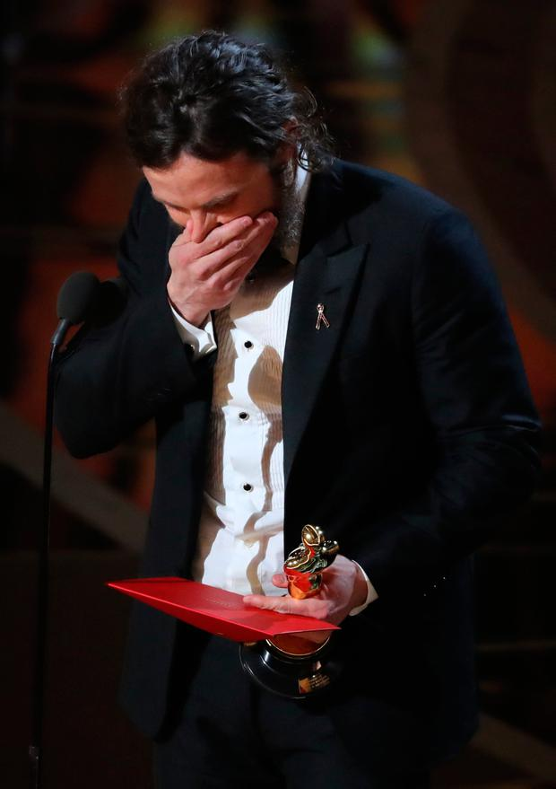 Casey Affleck reacts as he accepts the Best Actor Oscar for