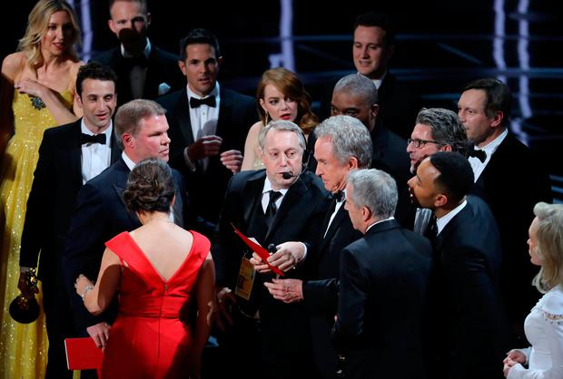 Warren Beatty holds the card for the Best Picture Oscar awarded to