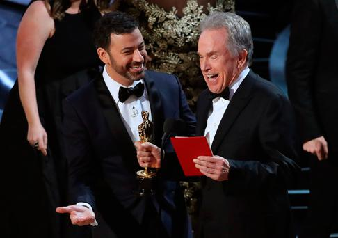 Jimmy Kimmel and Warren Beatty laugh after correcting the Best Picture Oscar from La La Land to Moonlight. REUTERS/Lucy Nicholson