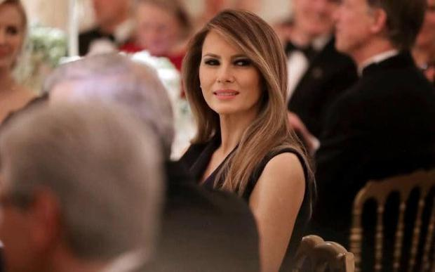 Melania Trump listens to Donald Trump's toast Photo: Getty images