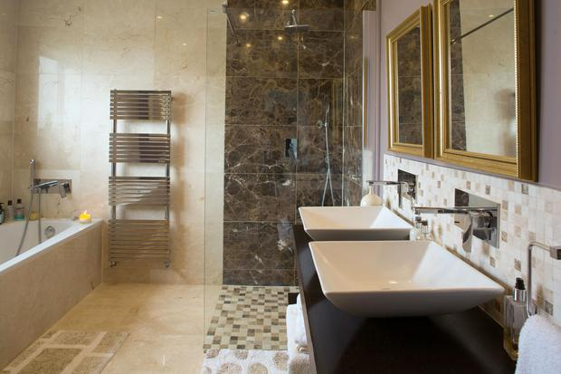 The walls and floors of the bathroom are tiled in marble, while the sanitary ware was all bought in Drogheda
